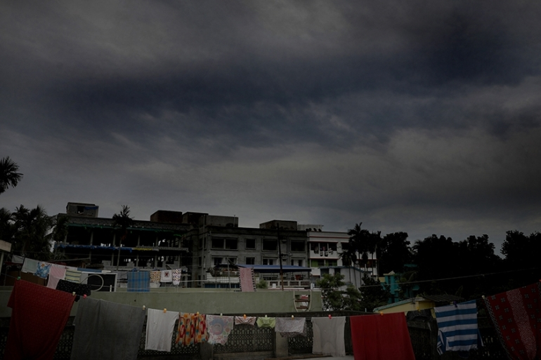 Dense rain clouds gather in the sky as cyclone Amphan gathers strength in the Bay of Bengal [Piyal Adhikary/EPA]