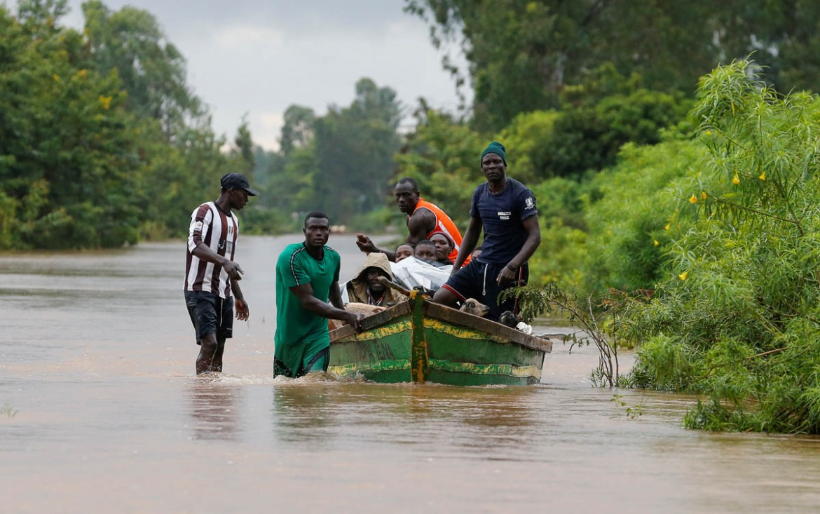 The latest flooding has left more than 1,800 families homeless. [Thomas Mukoya/Reuters]