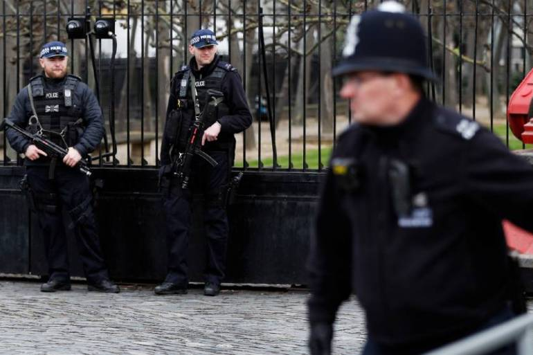Armed police stand guard outside the Houses of Parliament on the first anniversary of the Westminster attack in which a police officer and four pedestrians were killed in London on March 22, 2017 [File: Peter Nicholls/Reuters]