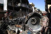 A Pakistan International Airlines Airbus A320 crashed into a residential area of Karachi, Pakistan, on May 24, killing 98 people [File: Shahzaib Akber/EPA]
