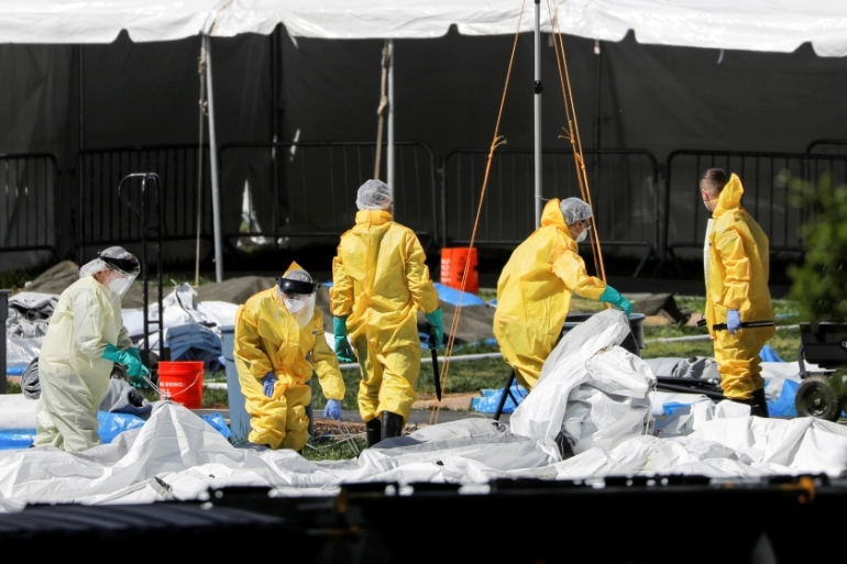 People in Personal Protective Equipment (P.P.E.) work to break down an area of The Samaritan''s Purse Emergency Field Hospital in Central Park during the outbreak of the coronavirus disease (COVID-19) in the Manhattan borough of New York City, U.S., May 9, 2020. REUTERS/Andrew Kelly  [Reuters]