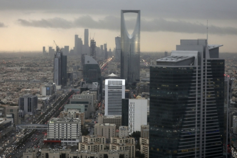 The news of the Saudi Public Investment Fund's buying spree abroad coincided with the government cutting back on spending at home after a crash in global oil prices [File: Bloomberg]