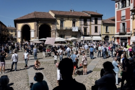 Crowds of people gather to watch an aerobatic demonstration by the Italian Air Force, in the town of Codogno as Italy starts to ease its coronavirus lockdown, May 25 [Marzio Toniolo/Reuters]