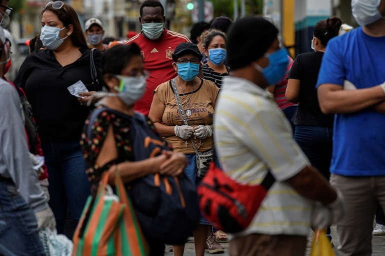 People line up outside of a pharmacy amid the outbreak of the coronavirus disease (COVID-19), in Guayaquil, Ecuador [Santiago Arcos/Reuters]