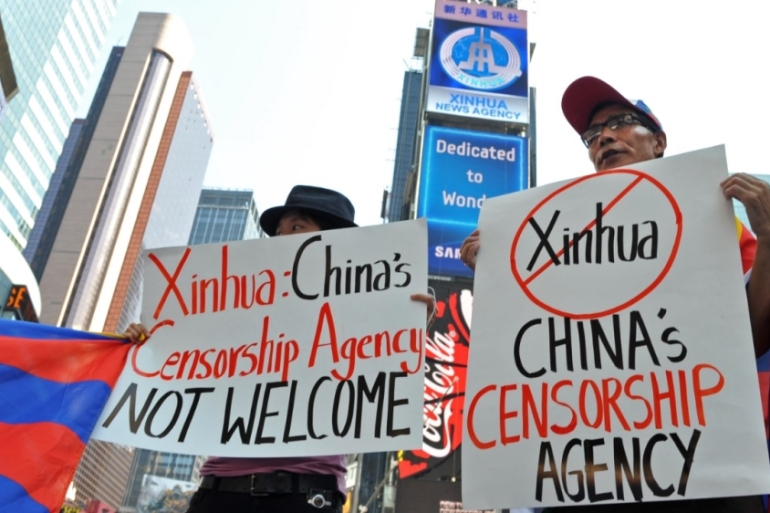 Members of the Free Tibet movement protest in New York against the state-owned Xinhua news agency in New York [Stan Honda/AFP]