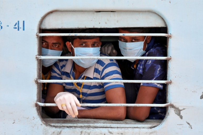 Migrant workers look out of a train window upon their arrival in their home state of West Bengal [Rupak De Chowdhuri/Reuters]