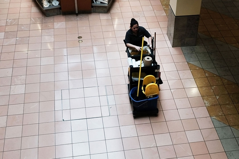 The work of custodians and janitors has become even more important during the pandemic [File: Spencer Platt/Getty Images/AFP]