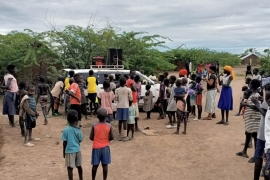 A vehicle drives through Kakuma, broadcasting multilingual messages about the coronavirus [Credit: Capital Juba studios]