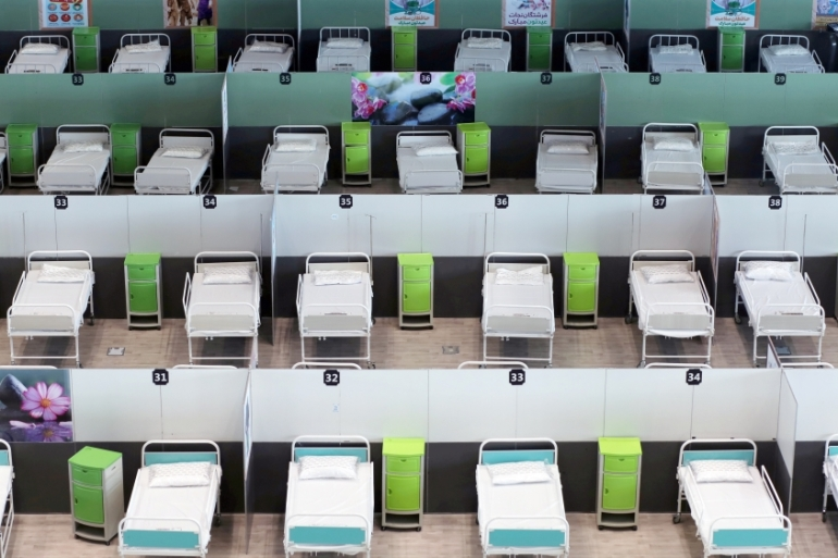 A view of beds at a shopping mall in Tehran, one of Iran's largest, which has been turned into a centre to receive coronavirus patients [File: Ali Khara/WANA via Reuters]