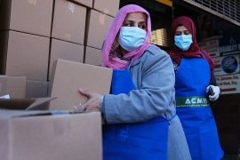 Halal food boxes are distributed to those in need during Ramadan o in the Brooklyn borough of New York City [Spencer Platt/Getty Images/AFP]