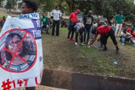 A protester holds a banner in 2019 against the Malawi Electoral Commission (MEC) chairperson Jane Ansah during a demonstration by opposition supporters [File: Amos Gumulira/AFP]