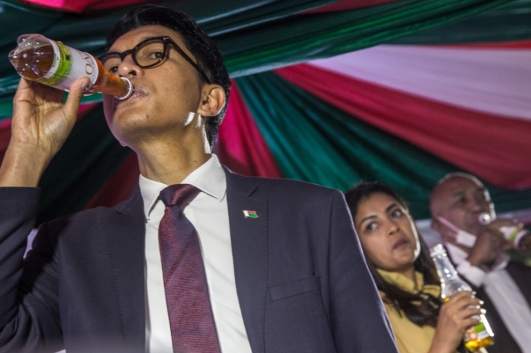 Madagascar's President Andry Rajoelina launched the purported concoction at a ceremony last month [Rijasolo/AFP]