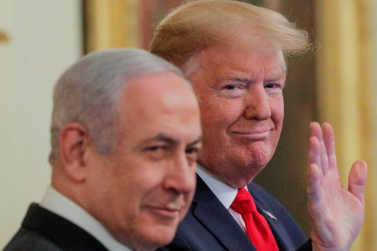 US President Donald Trump waves next to Israel's Prime Minister Benjamin Netanyahu prior to announcing his Middle East plan in Washington on January 28, 2020 [Reuters/Brendan McDermid]