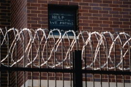 Signs made by prisoners pleading for help are seen on a window of Cook County Jail in Chicago, Illinois, US, April 7, 2020, amid the COVID-19 outbreak [Jim Vondruska/Reuters]