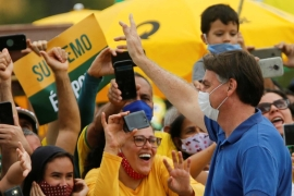 Brazil's President Jair Bolsonaro greets supporters during a protest against the President of the Chamber of Deputies (Rodrigo Maia), the Brazilian Supreme Court, and quarantine and social-distancing measures in Brasilia [Adriano Machado/Reuters]