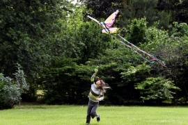 A child plays with a kite at a park in Milan as Italy begins a staged end to a nationwide lockdown [Flavio Lo Scalzo/Reuters]