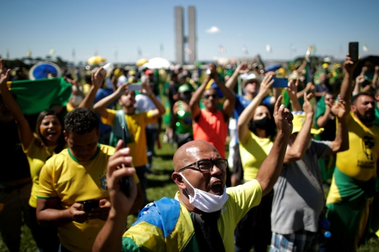 Supporters of far-right Brazilian President Jair Bolsonaro take part in a protest on Sunday in Brasilia [Ueslei Marcelino/Reuters]