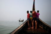 Rohingya refugees crew a fishing boat in the Bay of Bengal near Cox's Bazaar, Bangladesh [File: Clodagh Kilcoyne/Reuters]
