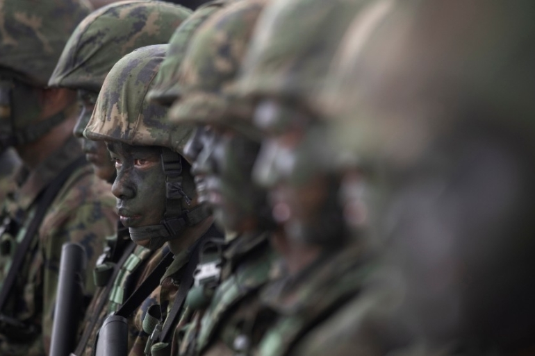 Thai soldiers take part in military exercises with the United States. Human rights groups have raised concern about an alleged culture of abuse within the armed forces [File: Sakchai Lalit/AP Photo]   [The Associated Press]