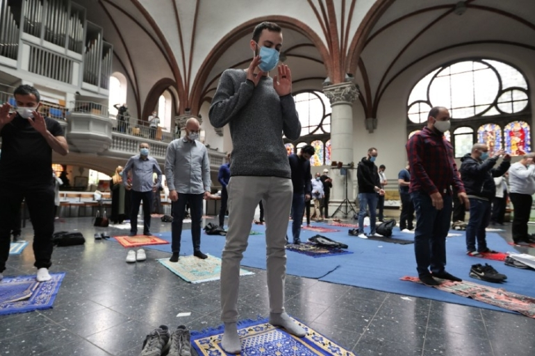 The Martha Lutheran church hosted Muslim prayers in Arabic and German [Fabrizio Bensch/Reuters]