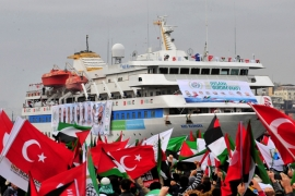 Pro-Palestinian activists wave Turkish and Palestinian flags during the welcoming ceremony for cruise liner Mavi Marmara [File: Reuters]