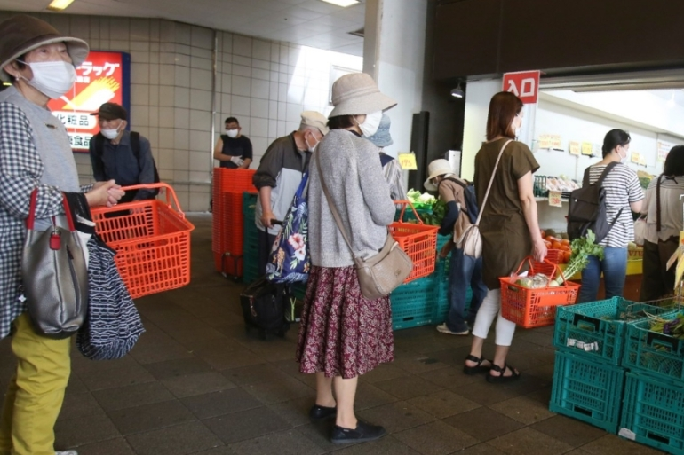 Japanese experts and officials have urged people to adopt 'new lifestyles' [Koji Sasahara/AP]