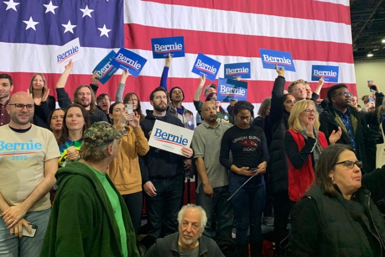 A draft Democratic Party platform approved on Monday rejects many of the more ambitious proposals championed by progressives like Bernie Sanders during the primaries. [File: Jeremy Young/Al Jazeera]