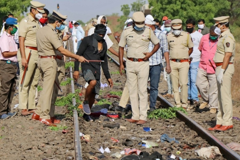 Police officers examine the railway track after a train ran over migrant workers sleeping on the track in Aurangabad district in the western state of Maharashtra [Reuters]