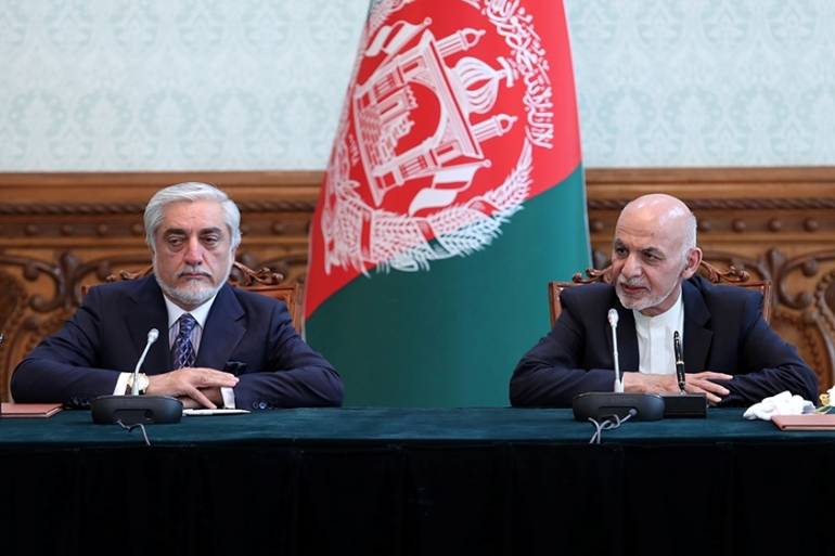 Ashraf Ghani and Abdullah Abdullah signed a power-sharing deal to end a months-long political stalemate [Handout via Reuters]