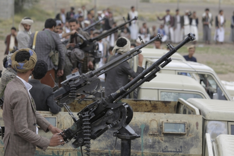 Houthi rebel fighters ride on trucks mounted with weapons during a gathering aimed at mobilising more fighters for the Houthi movement in Sanaa [File:Hani Mohammed/The Associated Press]