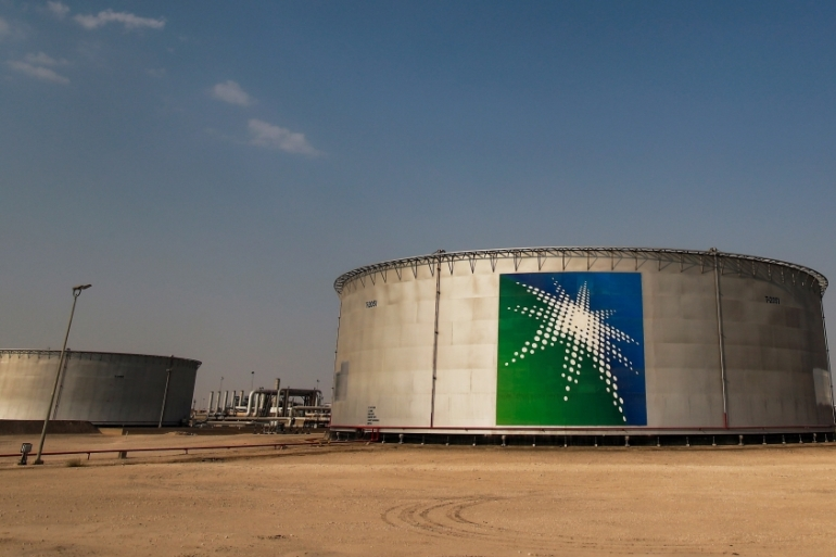 A view shows branded oil tanks at Saudi Aramco's oil facility in Abqaiq, Saudi Arabia [File: Maxim Shemetov/Reuters]