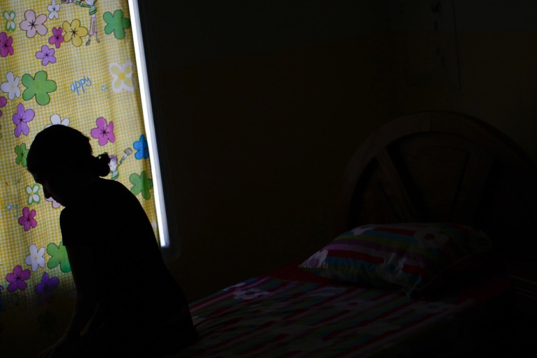 A woman sits in a shelter for domestic violence victims [File: Reuters]
