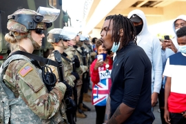 A man confronts a United States National Guard member in Minneapolis as protesters rally over the death of George Floyd in police custody [Lucas Jackson/Reuters]