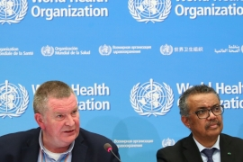 World Health Organization officials Michael Ryan (left) and Tedros Adhanom Ghebreyesus (right) warn against the notion in some countries that their populations will quickly build so-called 'herd immunity' [Denis Balibouse/Reuters]