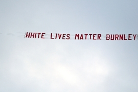 A small aircraft (out of frame) flew a 'White Lives Matter Burnley' banner over Manchester City stadium [Shaun Botterill/EPA]