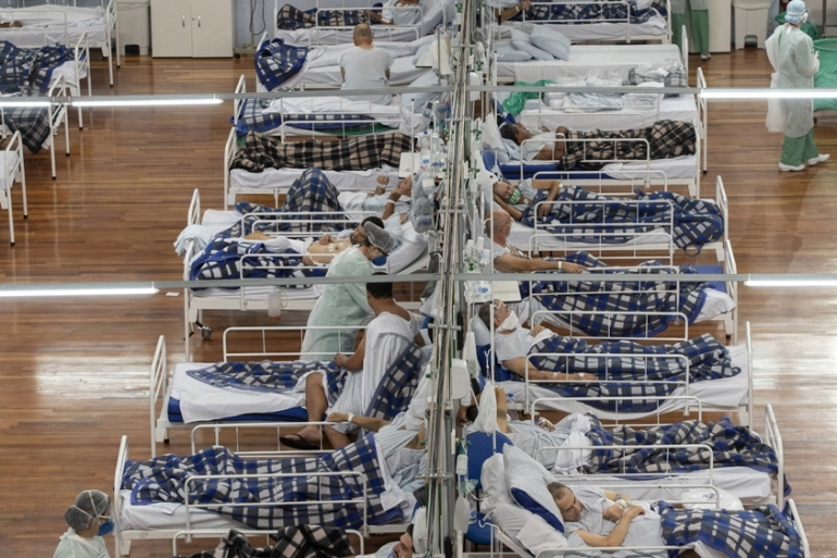 COVID-19 patients in a field hospital inside a gym in Santo Andre, on the outskirts of Sao Paulo, one of Brazil's most hard-hit cities [Andre Penner/AP Photo]