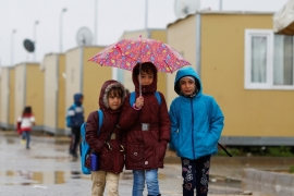 Syrian refugee children walk in Elbeyli refugee camp near the Turkish-Syrian border in Kilis province, Turkey on December 1, 2016 [File: Reuters/Umit Bektas]
