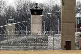 Guard towers and razor wire ring the compound at the US Penitentiary in Terre Haute, Indiana where the US government will conduct the first federal executions in 17 years [File: Michael Conroy/AP Photo]