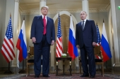 US President Donald Trump and Russian President Vladimir Putin stand together before their meeting in Helsinki, Finland, Monday, July 16, 2018 [AP Photo/Pablo Martinez Monsivais]
