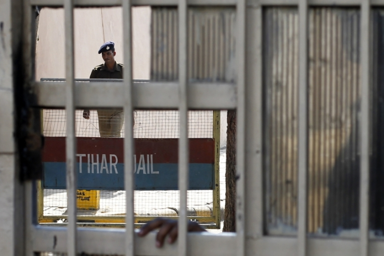 A policeman walks inside the Tihar Jail in New Delhi on March 11, 2013 [Reuters/Mansi Thapliyal]