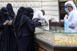 Saudi women buy jewellery on Monday at a shop in the gold market before the expected increase of VAT to 15 percent in Riyadh, Saudi Arabia, which is facing an unprecedented economic slump [File: Ahmed Yos/Reuters]
