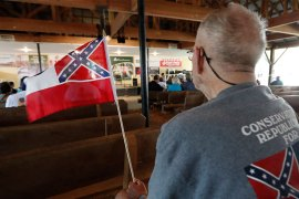 Carl Ford of Laurel waves his Mississippi state flag during speeches at the Neshoba County Fair in Philadelphia, Mississippi [File: Rogelio V Solis/AP Photo]