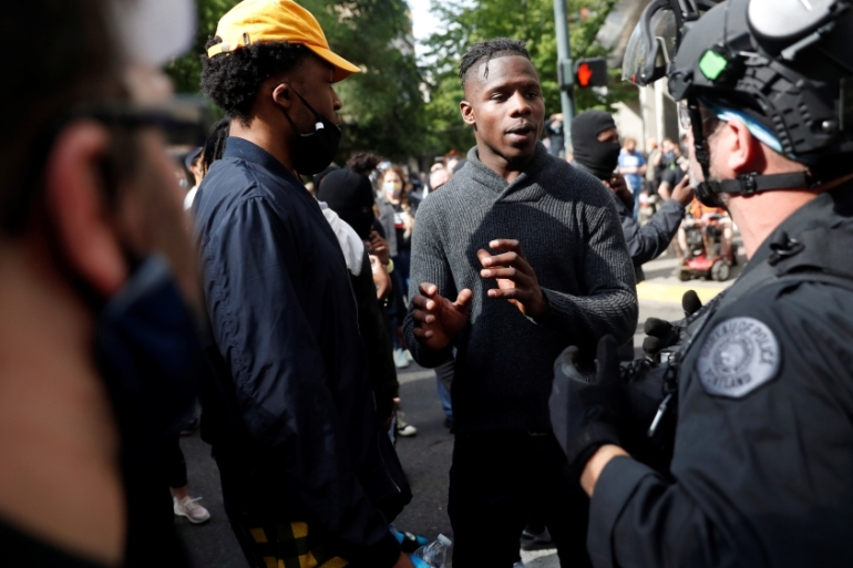 Lyfe Tavarres, of Portland, negotiates with police during a protest against the death in Minneapolis police custody of George Floyd, in Portland, Oregon, United States [File:Terray Sylvester/Reuters]