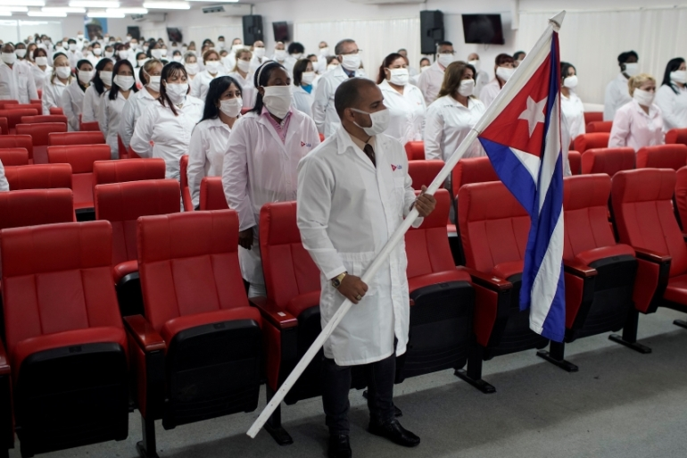 Cuban doctors attend a farewell ceremony before departing to Kuwait to assist the country's ongoing fight against COVID-19, Havana, Cuba on June 4, 2020 [Alexandre Meneghini/Reuters]