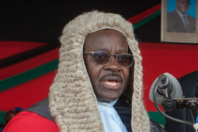 Chief Justice Andrew Nyirenda had led the Supreme Court decision which rejected Mutharika's bid to overturn a ruling quashing his controversial re-election [File: Amos Gumulira/AFP]
