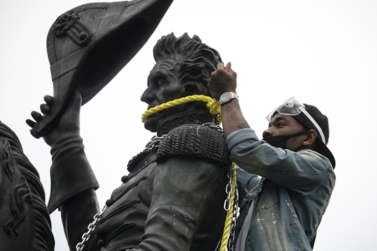 Protesters attempt to pull down the statue of Andrew Jackson in Lafayette Square near the White House [Tasos Katopodis/Getty Images/AFP]