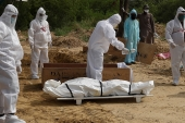 The pandemic has so far killed some 3.3 million people worldwide [File: Adnan Abidi/Reuters]