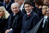 Israeli Prime Minister Benjamin Netanyahu and Canadian Prime Minister Justin Trudeau seen at a commemoration ceremony for Armistice Day, at the Arc de Triomphe, in Paris, France, November 11, 2018 [File: Francois Mori/Reuters]
