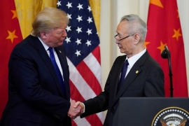US President Donald Trump shakes hands with Chinese Vice Premier Liu He after signing 'phase one' of the US-China trade agreement in Washington, US on January 15, 2020 [File: Reuters/Kevin Lamarque]
