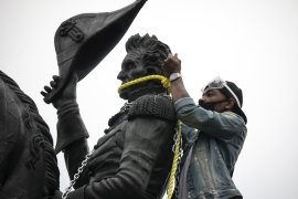 Protesters tie ropes around the statue of Andrew Jackson in Lafayette Square near the White House. [Tasos Katopodis/Getty Images/AFP]